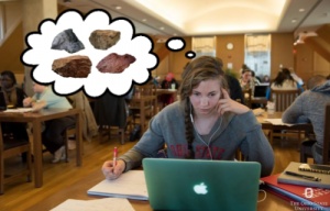Anna with thought bubble showing rocks