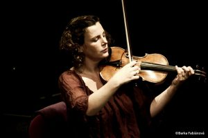 photo of a woman playing a violin