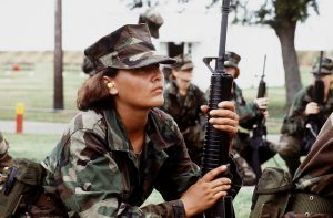 photo of a female soldier holding a rifle