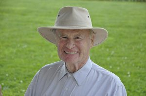 photo of an older gentleman smiling and wearing a hat